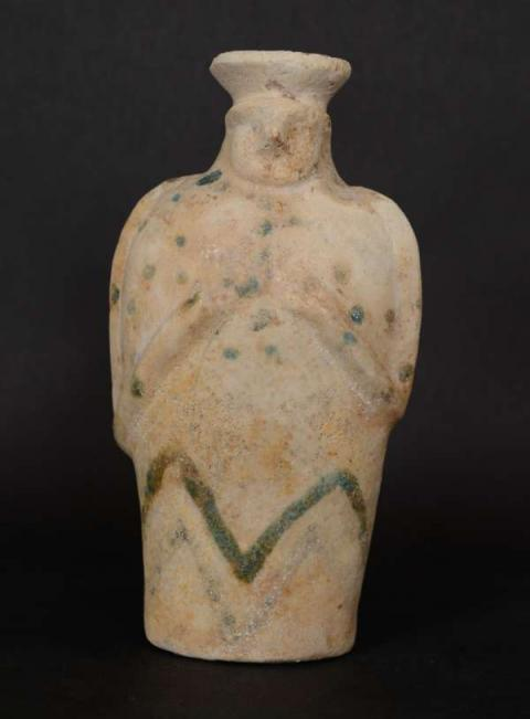 An elamite glazed composition figural vessel.